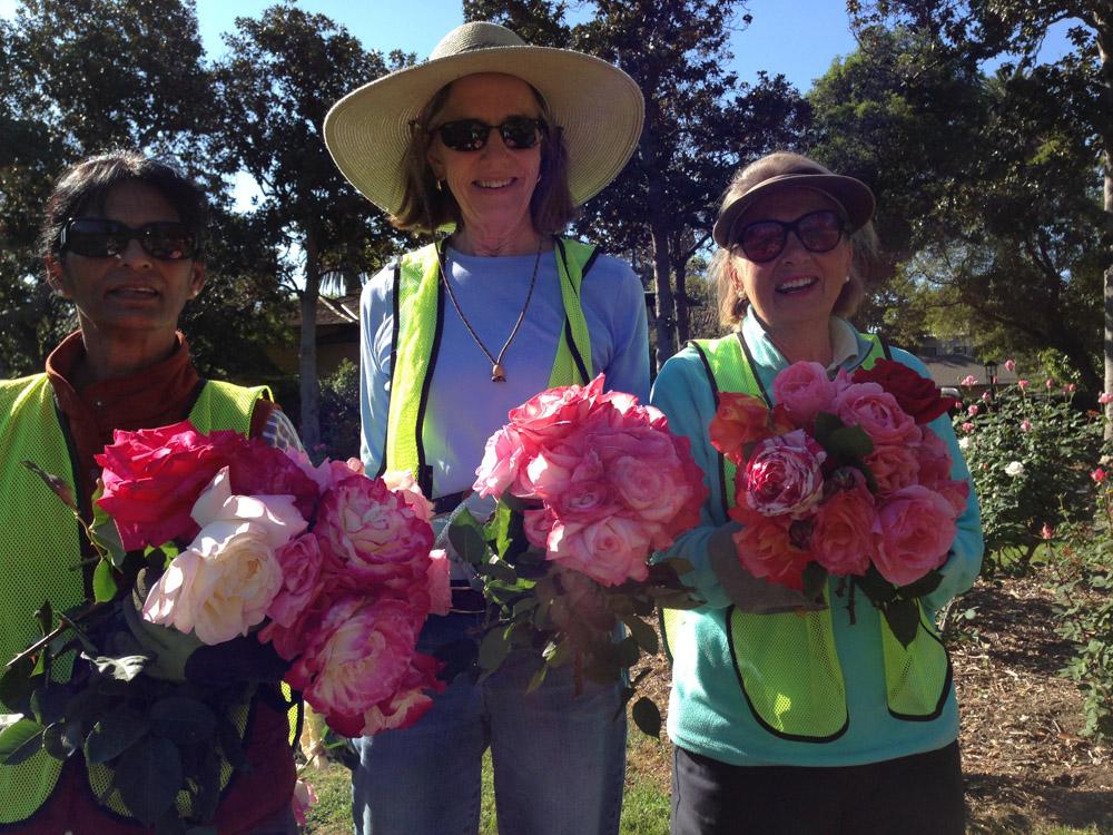 PBF Volunteers holding roses