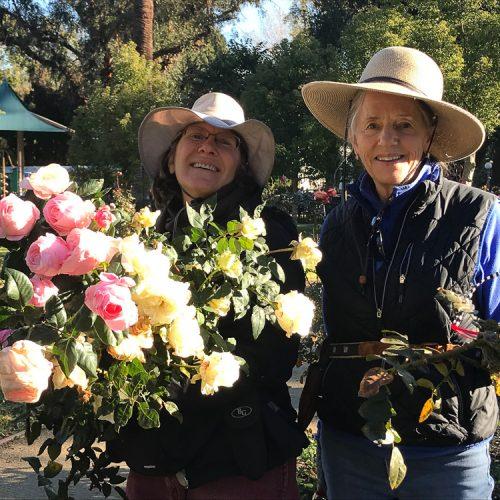 Pasadena Beautiful Volunteers holding roses